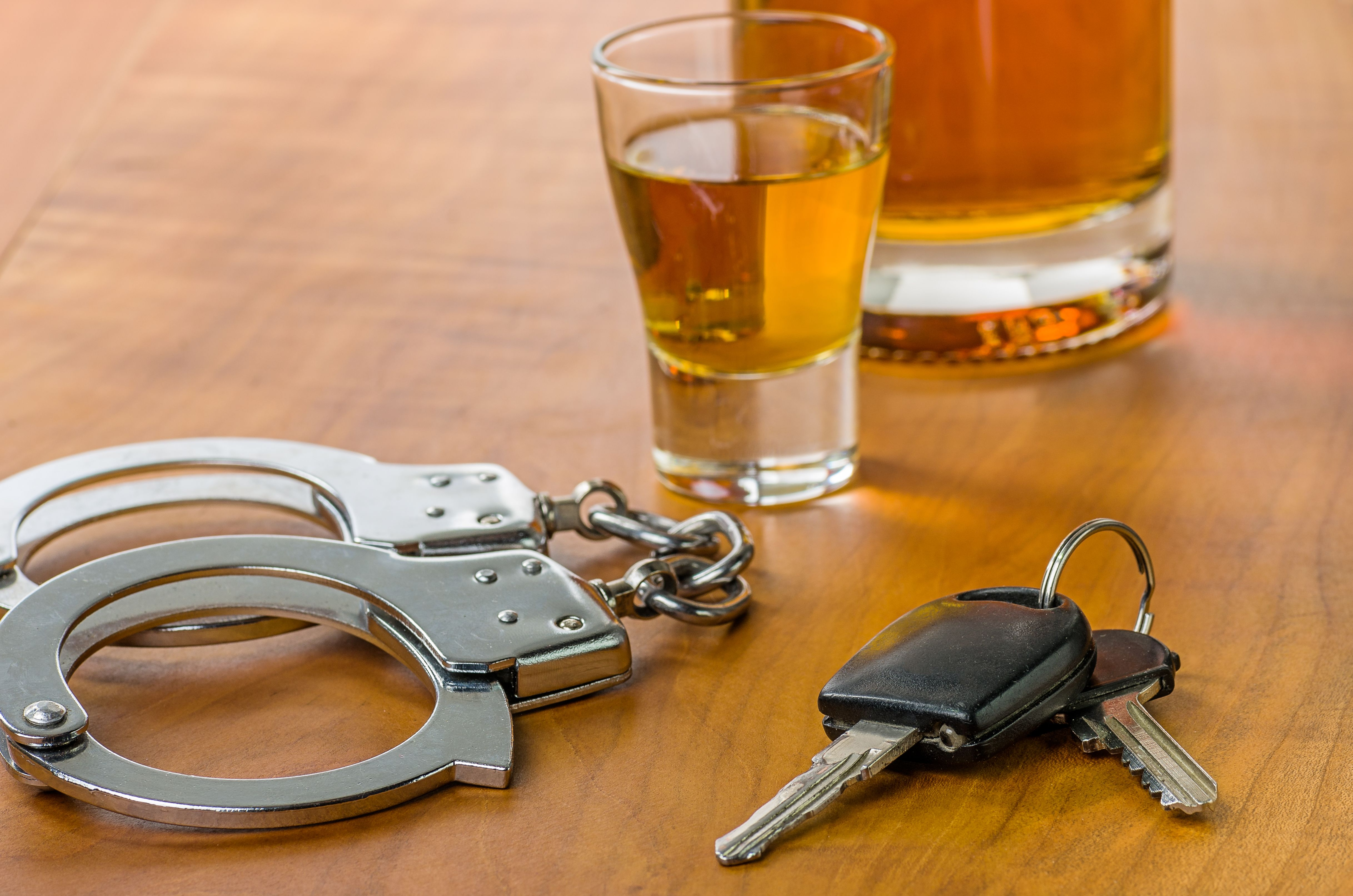 Whiskey, handcuffs and car keys - Seminole County DUI Lawyer